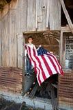 Muchacho que cuelga el indicador americano Foto de archivo