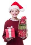 Muchacho que da los regalos de la Navidad Imagen de archivo