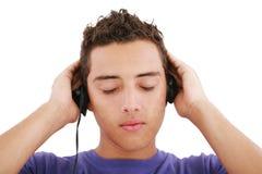 Muchacho que escucha la música Imagenes de archivo