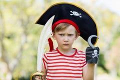 Muchacho que finge ser un pirata Imagenes de archivo