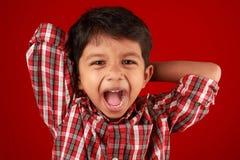 muchacho que grita Foto de archivo