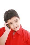 Muchacho que habla con el teléfono celular Imágenes de archivo libres de regalías
