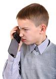 Muchacho que habla en el teléfono móvil Foto de archivo