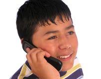 Muchacho que habla en un teléfono celular Fotografía de archivo libre de regalías