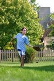 Muchacho que intenta coger la bola Foto de archivo