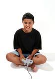 Muchacho que juega al juego video Fotos de archivo