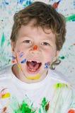 Muchacho que juega con la pintura Foto de archivo libre de regalías