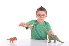 Muchacho que juega con los dinosaurios Imagen de archivo
