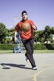 Muchacho que juega deportes Foto de archivo libre de regalías