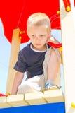 Muchacho que juega en el patio Fotografía de archivo libre de regalías
