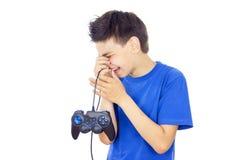 Muchacho que juega a juegos en la palanca de mando Imagen de archivo