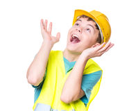 Muchacho que lleva el casco amarillo Foto de archivo