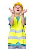 Muchacho que lleva el casco amarillo Imágenes de archivo libres de regalías