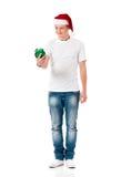 Muchacho que lleva el sombrero de Santa Claus Fotografía de archivo