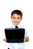 Muchacho que mira entusiástico la computadora portátil Imágenes de archivo libres de regalías