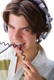 Muchacho que muerde un cable Foto de archivo libre de regalías