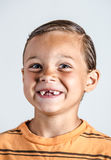 Muchacho que muestra los dientes que falta Fotografía de archivo libre de regalías