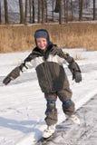 Muchacho que patina en el movimiento Foto de archivo libre de regalías