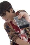 Muchacho que presenta con el telecontrol Fotografía de archivo