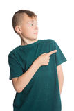 Muchacho que señala su finger al lado Fotos de archivo