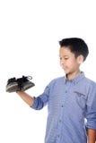 Muchacho que siente infeliz con el calcetín del blanco del mún olor fotos de archivo libres de regalías