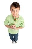 Muchacho que sostiene un lollipop Fotografía de archivo libre de regalías