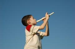 Muchacho que toca la flauta Imágenes de archivo libres de regalías