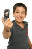 Muchacho que toma una foto con una célula Imagen de archivo libre de regalías