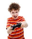 Muchacho que usa el regulador del juego video Imágenes de archivo libres de regalías