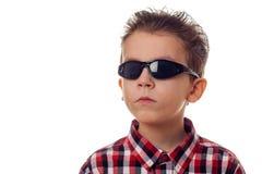 Muchacho serio con las gafas de sol Imagen de archivo
