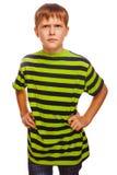 Muchacho serio melancólico rubio en una camisa rayada verde Imágenes de archivo libres de regalías