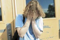 Muchacho solo triste en el patio de la escuela Fotos de archivo