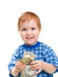 Muchacho sonriente con el billete de banco del dólar del dinero Fotos de archivo libres de regalías