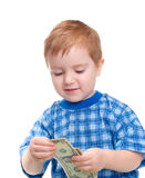 Muchacho sonriente con el billete de banco del dólar del dinero. Imágenes de archivo libres de regalías