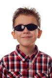 Muchacho sonriente con las gafas de sol Imágenes de archivo libres de regalías