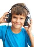Muchacho sonriente con los auriculares Foto de archivo libre de regalías