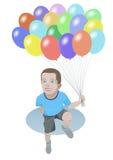 Muchacho sonriente con los globos del color Foto de archivo libre de regalías