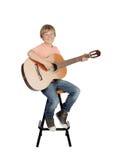 Muchacho sonriente con una guitarra Imágenes de archivo libres de regalías