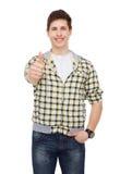 Muchacho sonriente del estudiante que muestra los pulgares para arriba Imagenes de archivo