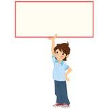 Muchacho sonriente feliz del estudiante de la historieta que lleva a cabo una muestra en blanco blanca Imagen de archivo libre de regalías