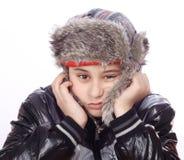 Muchacho triste con el sombrero del invierno Fotografía de archivo