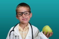 Muchacho vestido encima como de doctor Foto de archivo libre de regalías