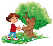 Muchacho y árbol Fotografía de archivo