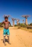 Muchacho y baobabs malgaches Imágenes de archivo libres de regalías
