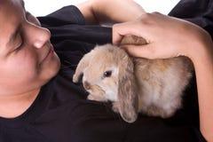 Muchacho y conejo Foto de archivo libre de regalías