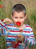 Muchacho y flor Foto de archivo libre de regalías