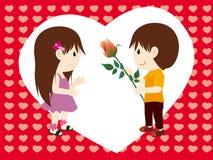 Muchacho y flores a la muchacha Imágenes de archivo libres de regalías