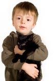 Muchacho y gatito. Fotos de archivo libres de regalías