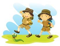 Muchacho y girl scout Fotos de archivo