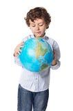 Muchacho y la tierra del planeta Foto de archivo